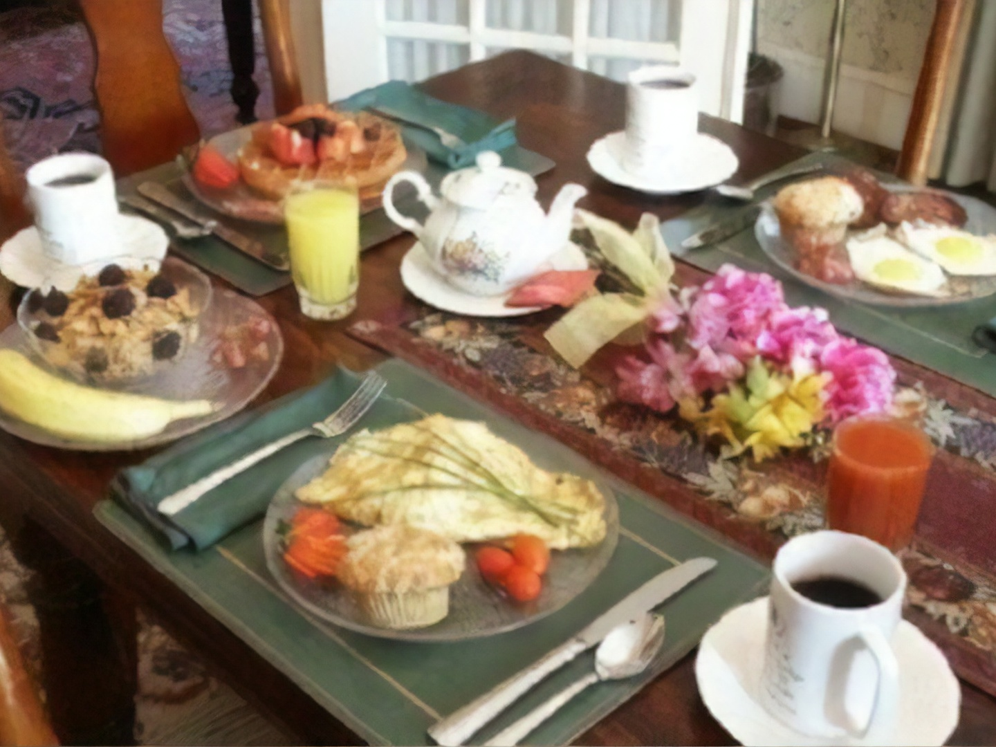 A plate of food and a cup of coffee on a table at A B&B at Llewellyn Lodge.