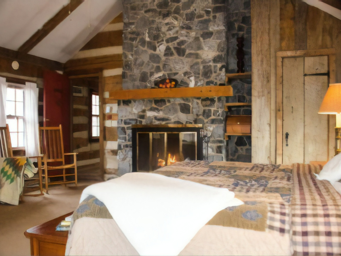 A room filled with furniture and a fire place at Sugar Tree Inn.