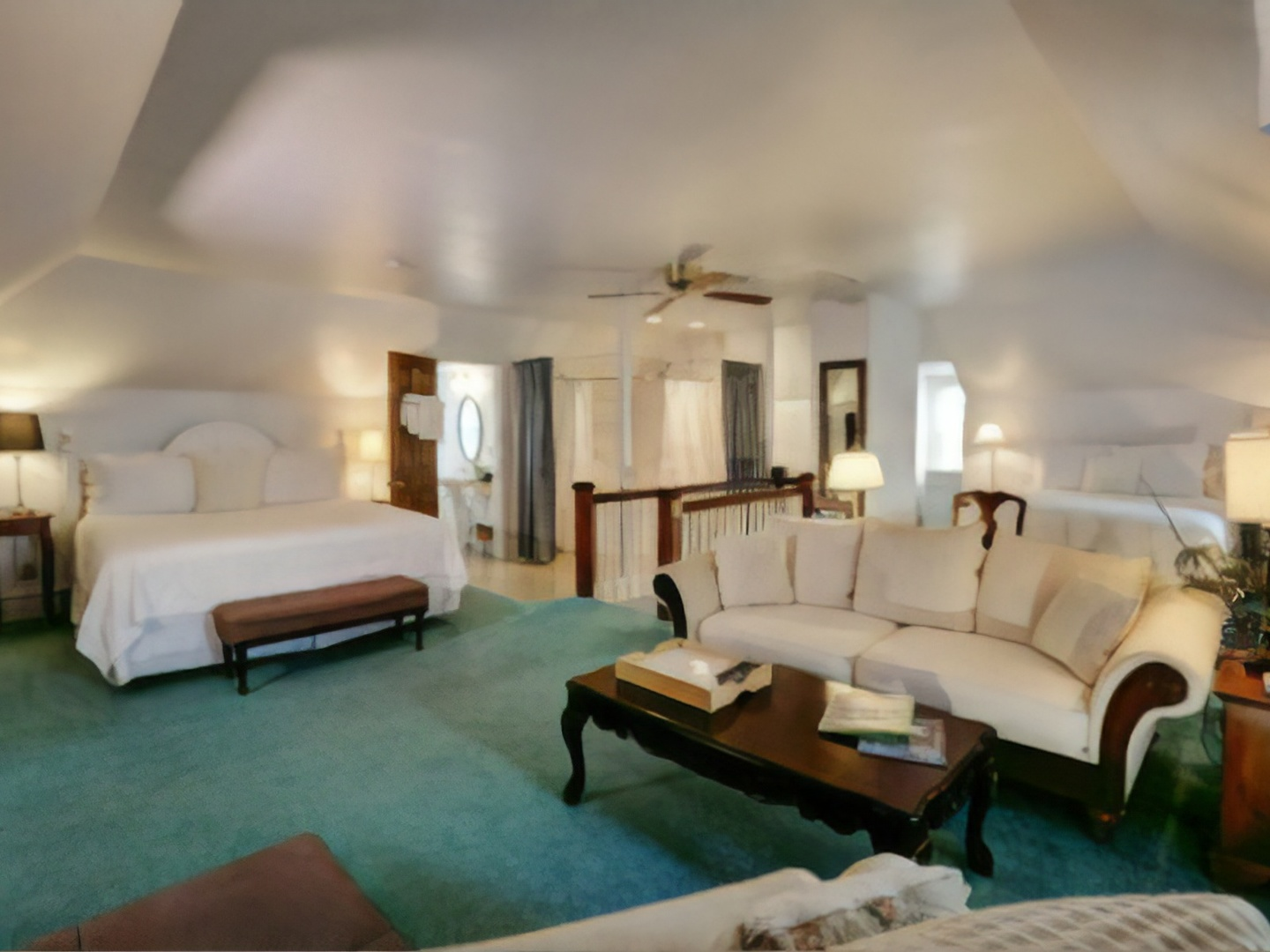 A living room filled with furniture and a bed at Olde Square Inn.