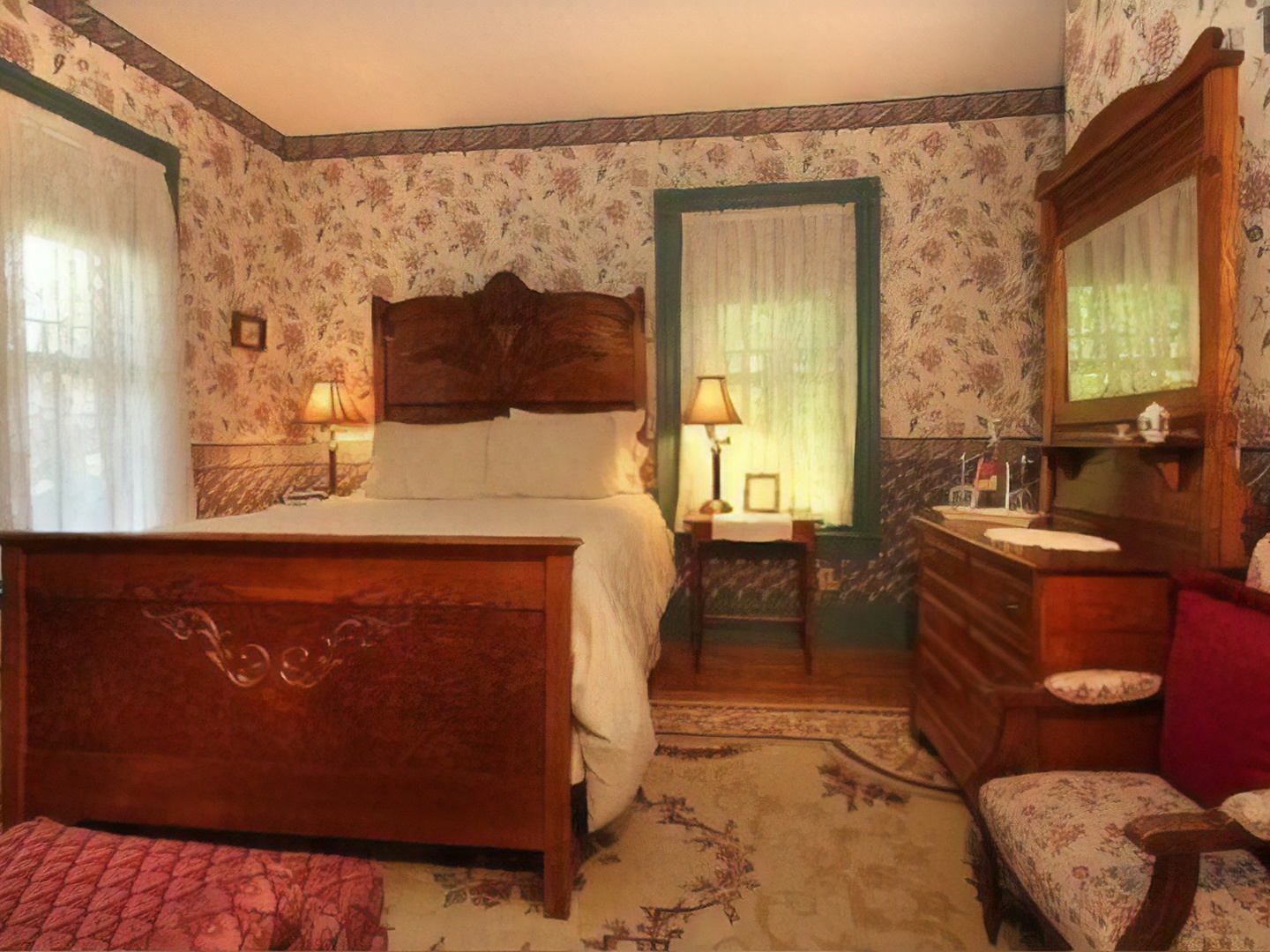 A bedroom with a bed and a fireplace at Manor House Inn.