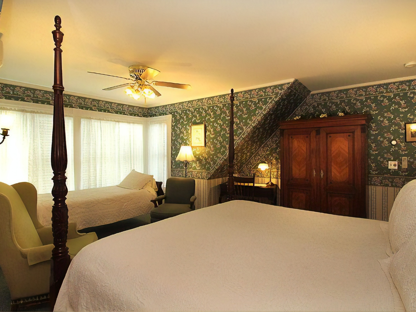 A bedroom with a large bed in a room at Manor House Inn.