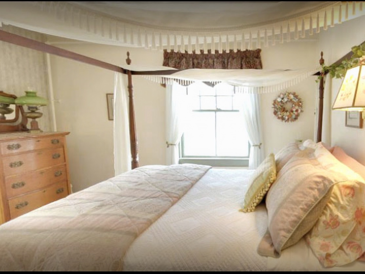 A bedroom with a large bed in a room at Inn at Tanglewood Hall.
