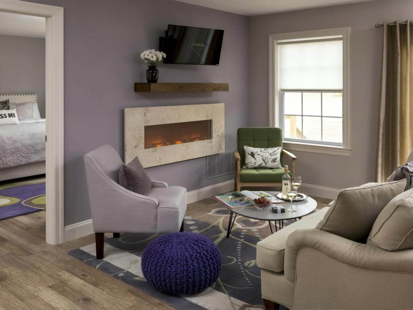 A living room filled with furniture and a window at Inn at Huntingfield Creek.