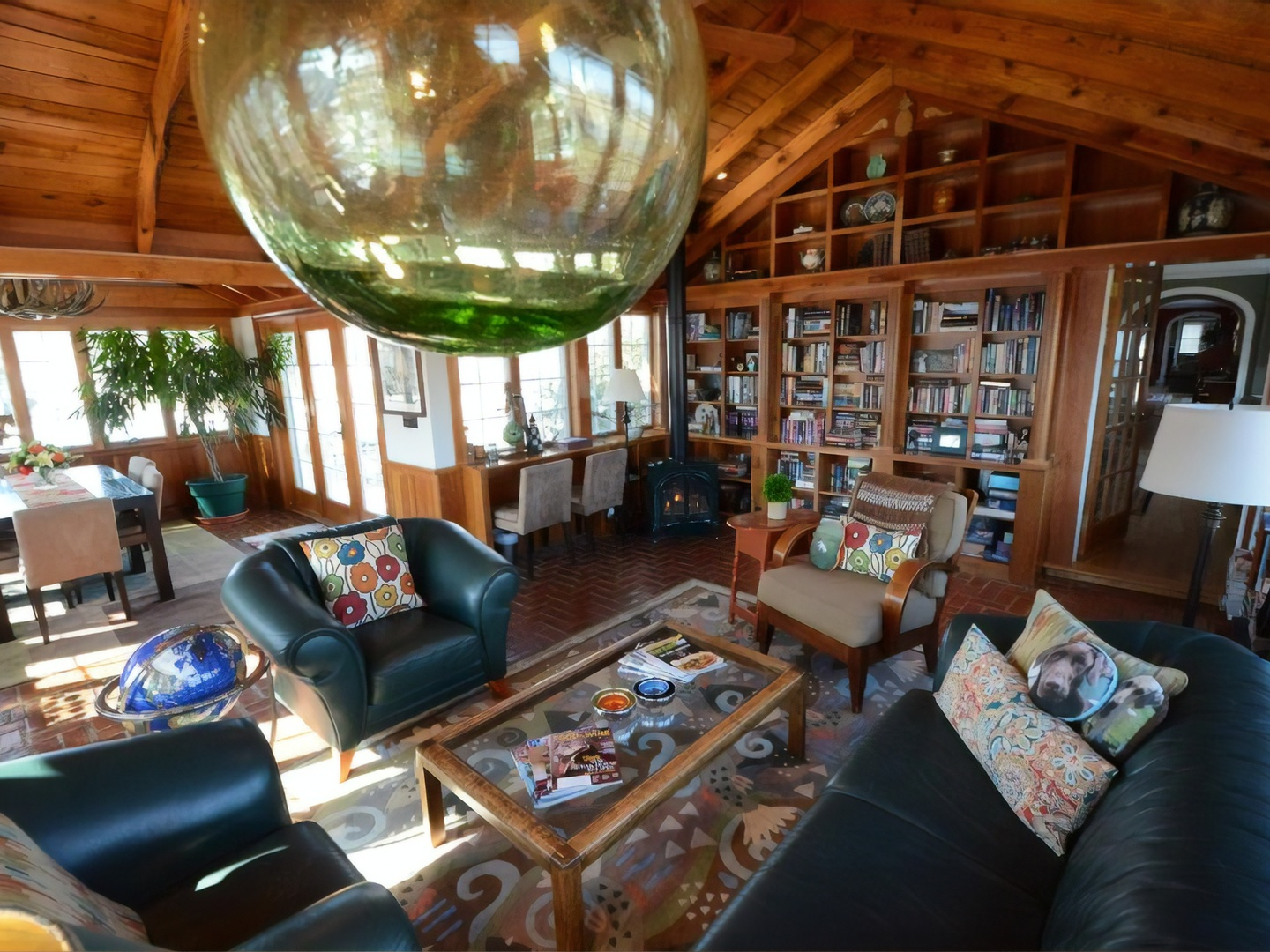 A living room filled with furniture and a large window at Inn at Huntingfield Creek.