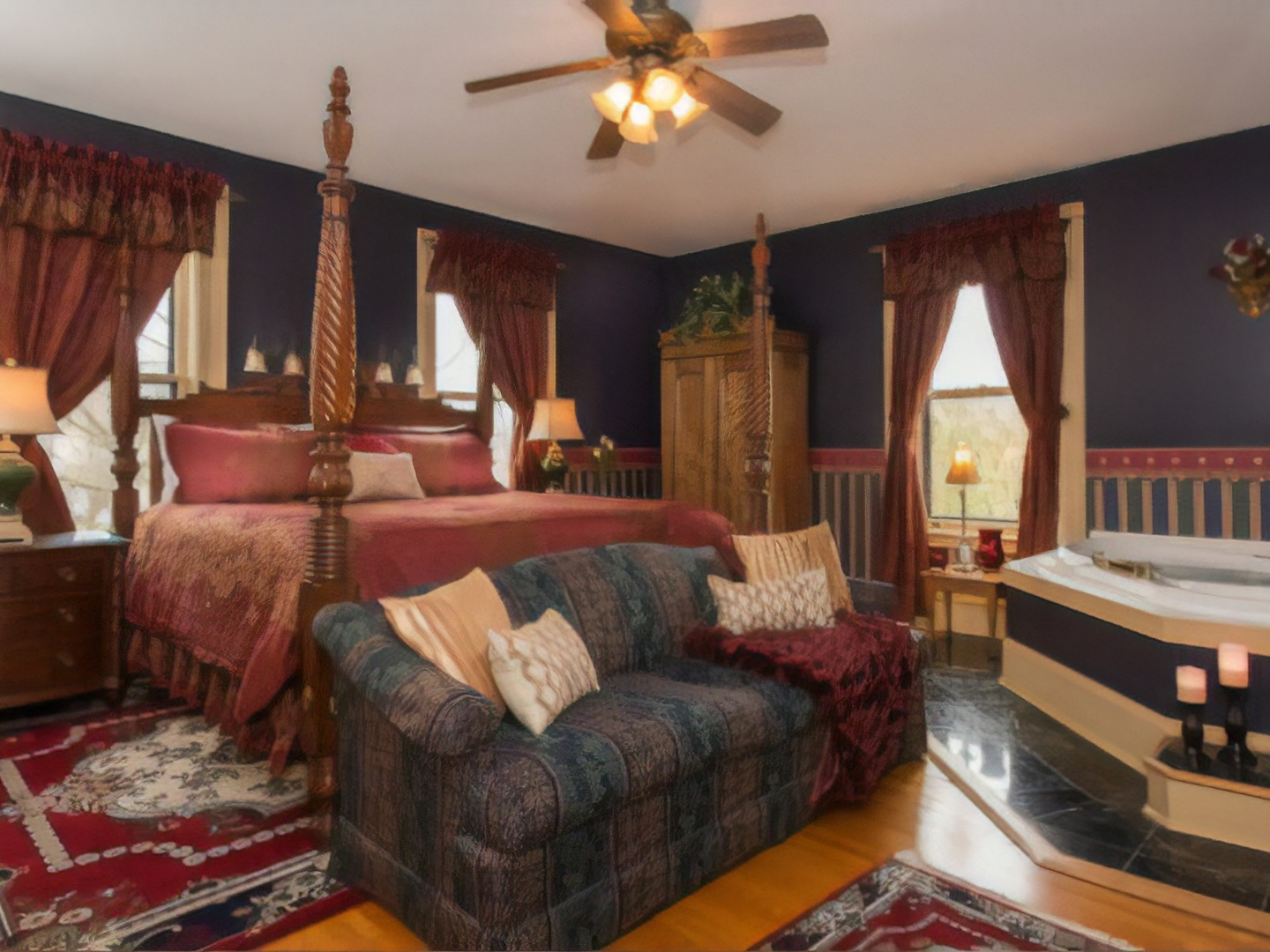 A living room filled with furniture and a fire place at 1840 Inn On the Main Bed and Breakfast.