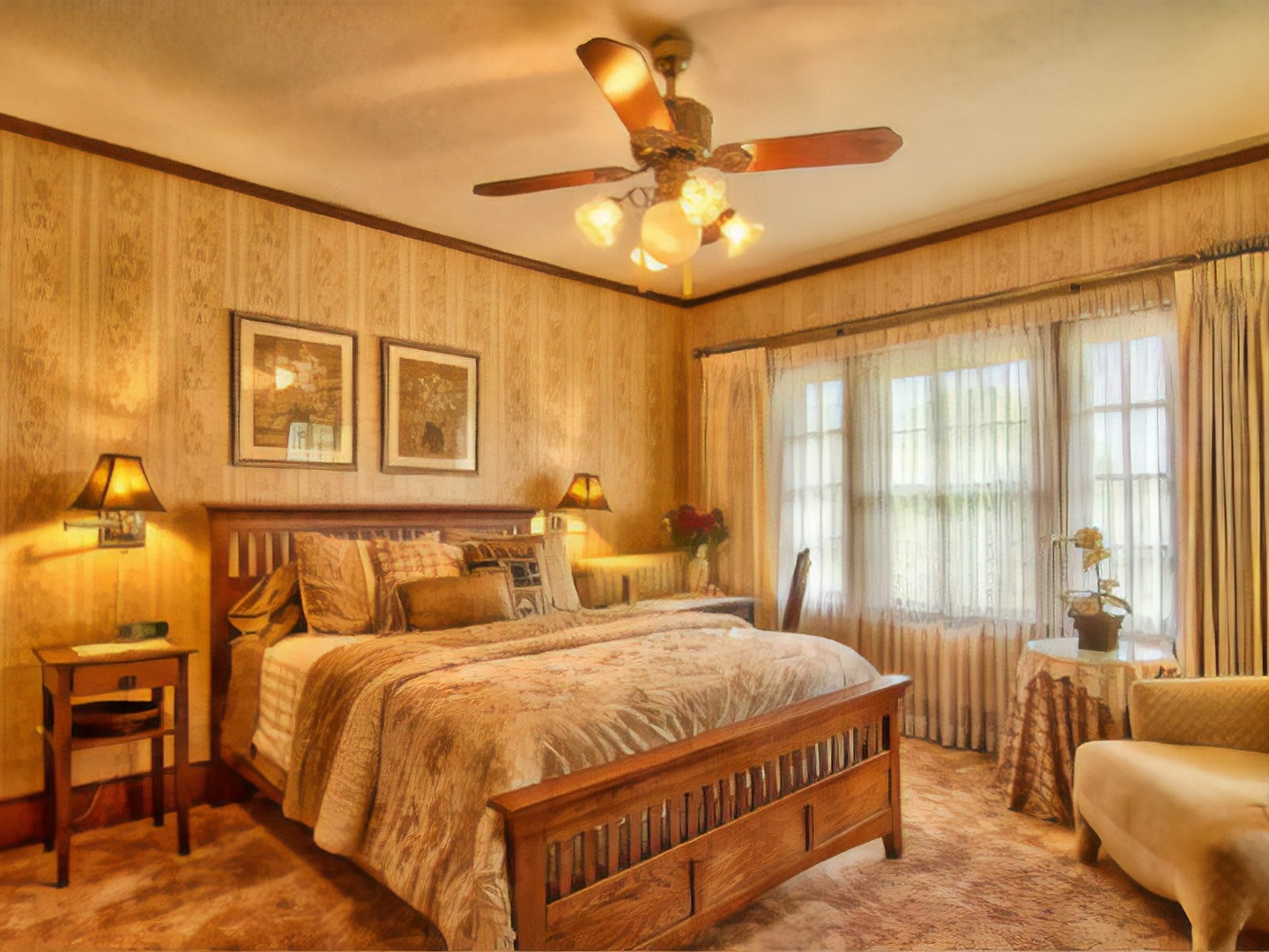 A bedroom with a large bed in a hotel room at Sweet Autumn Inn, LLC.