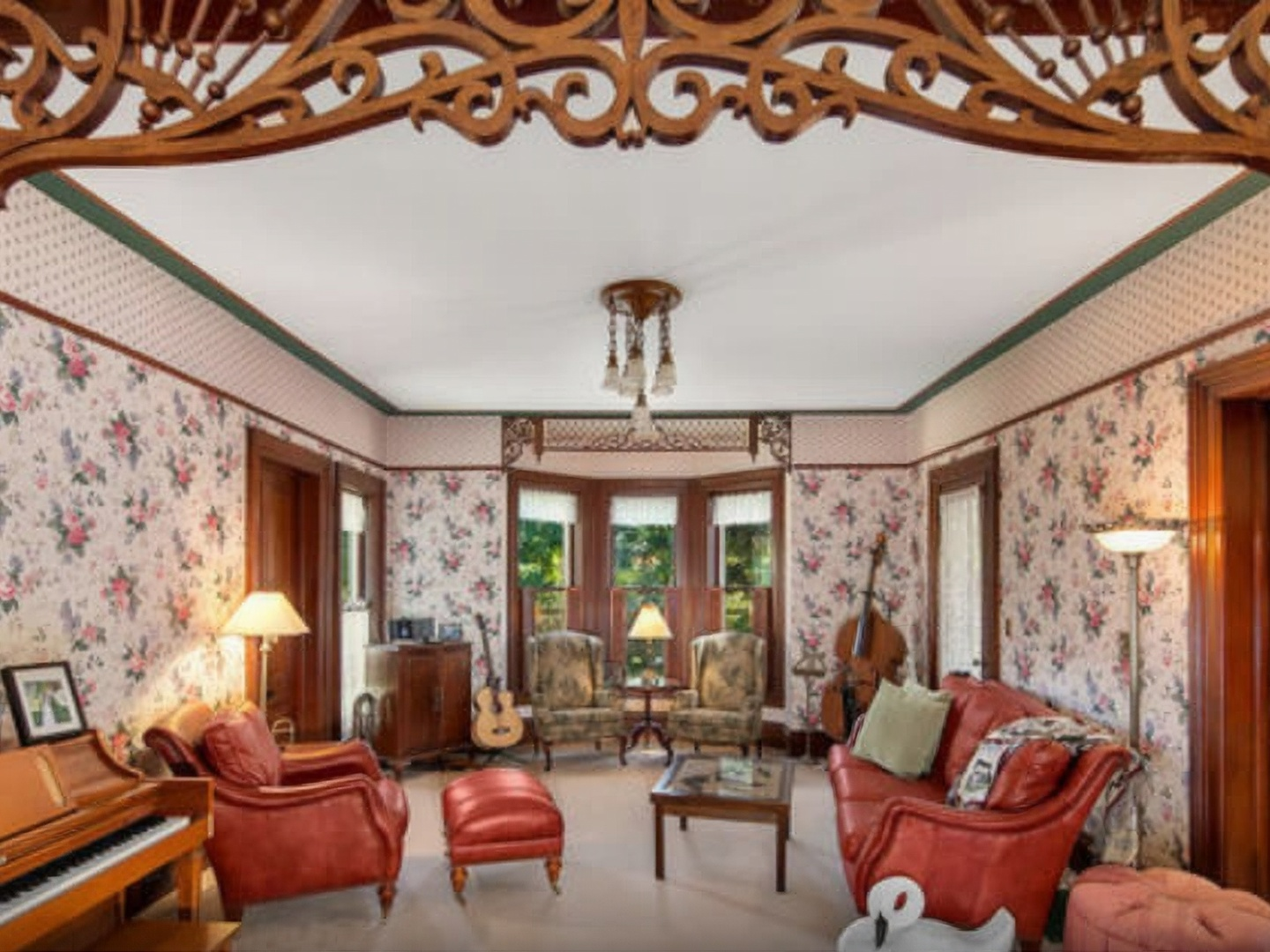 A living room filled with furniture and a large window at White Swan Inn B&B.