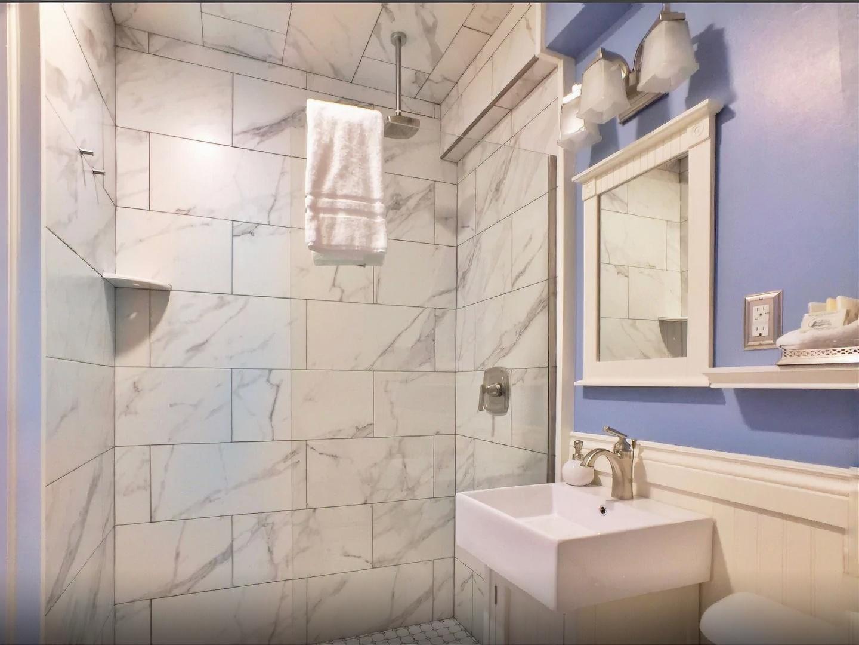 A white sink and a mirror at Willard Street Inn.