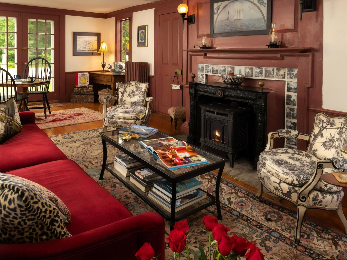 A living room filled with furniture and a fire place at Waldo Emerson Inn.