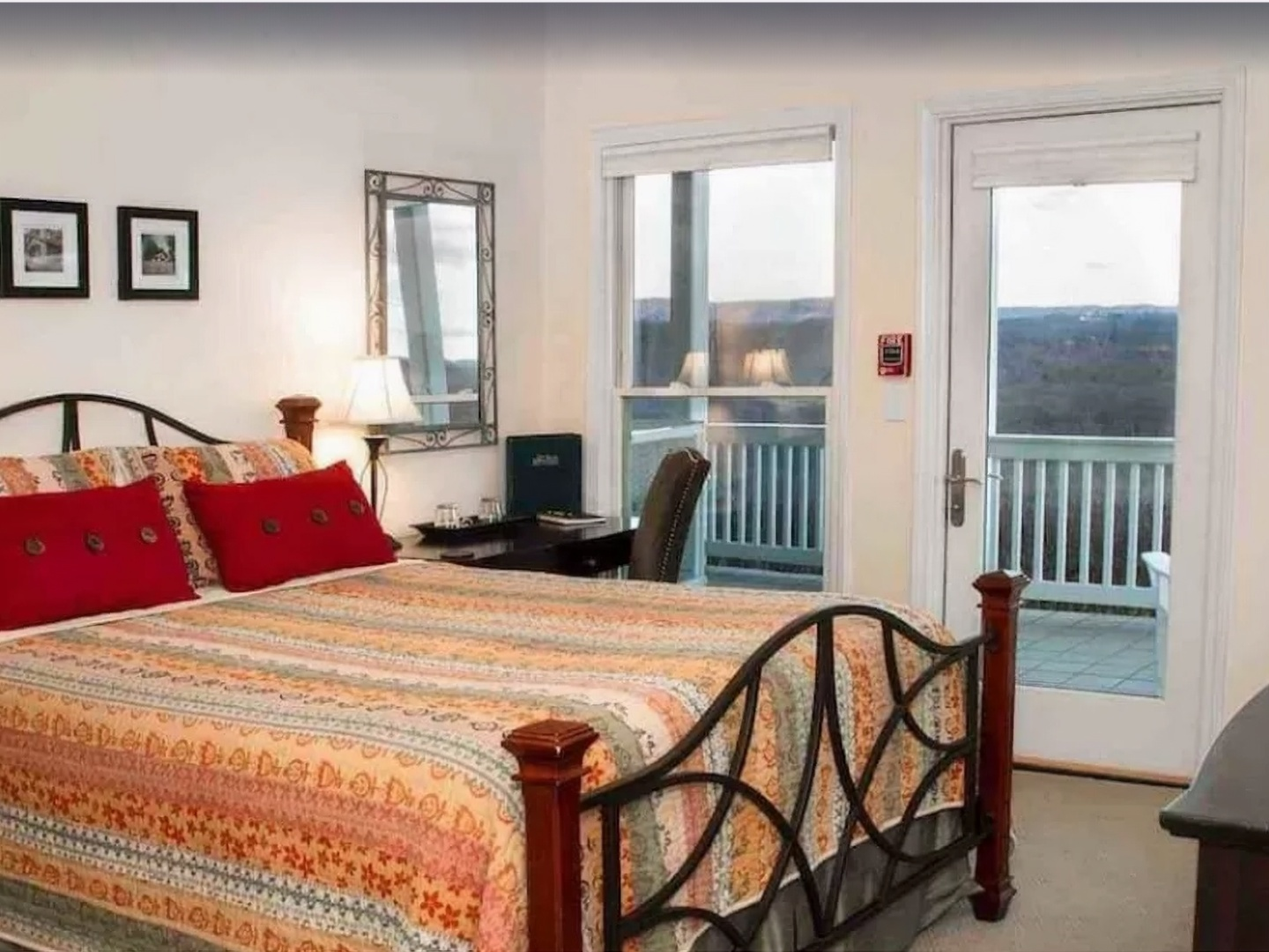 A bedroom with a bed and a chair in a room at Inn at Riverbend.