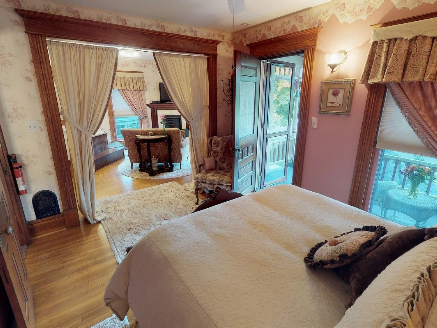 A bedroom with a bed and a fireplace at Bella Rose Bed and Breakfast.