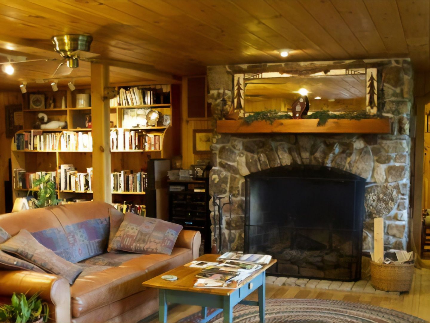 A fire place sitting in a living room filled with furniture and a fireplace at North Fork Mountain Inn Bed & Breakfast.