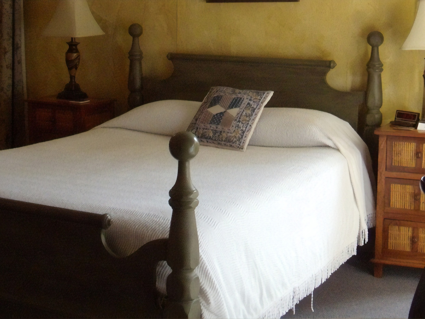 A bedroom with a bed in a hotel room at Pierre Coulon Guest House.