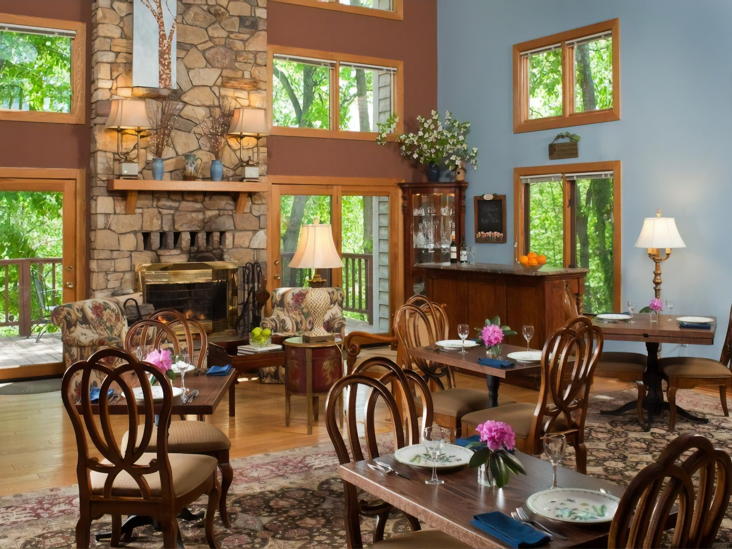A living room filled with furniture and a fire place at Iris Inn Bed and Breakfast.