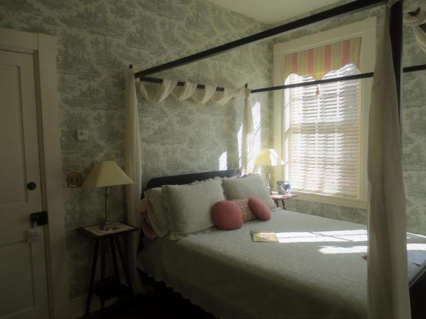 A bedroom with a bed and a mirror in a room at Rocky Springs Bed & Breakfast.