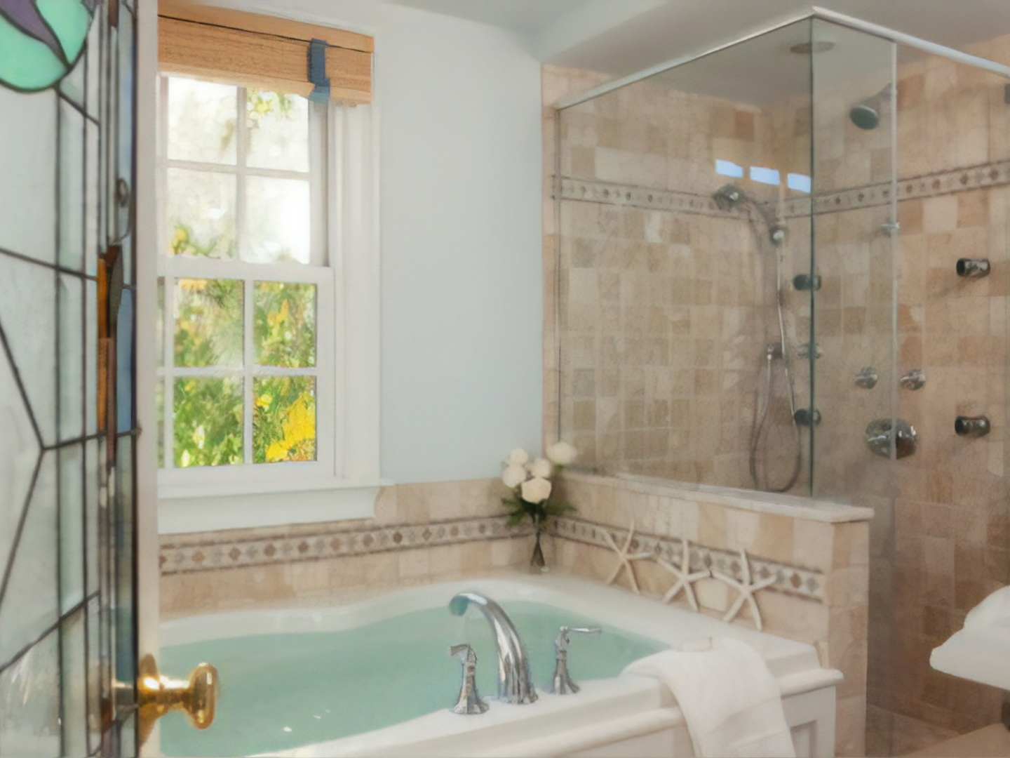 A large white tub next to a shower at The Provincetown Hotel at Gabriel's.
