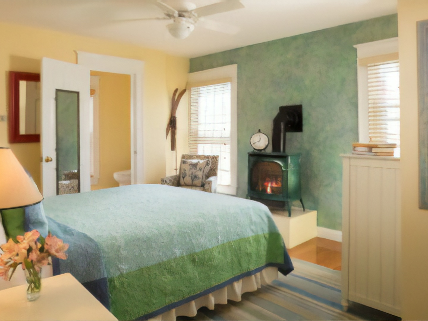A bedroom with a large bed in a room at The Provincetown Hotel at Gabriel's.