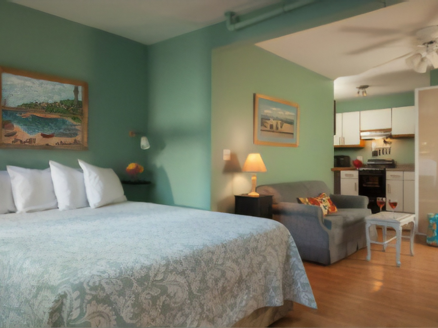 A bedroom with a large bed in a hotel room at The Provincetown Hotel at Gabriel's.