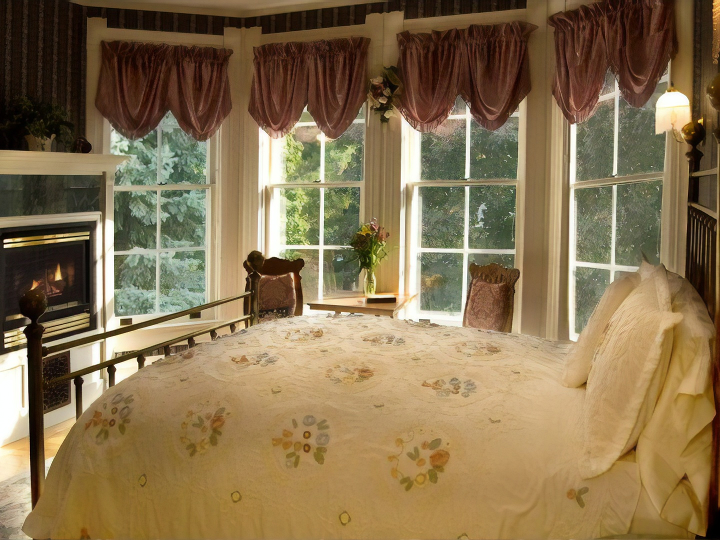 A bedroom with a bed and a large window at Phipps Inn Bed & Breakfast.