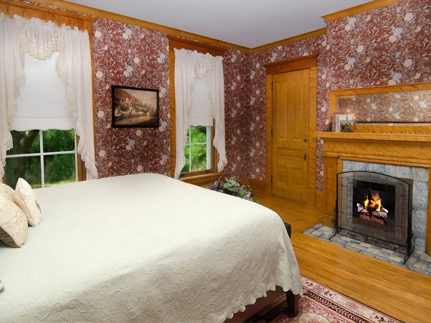 A bedroom with a bed and a fireplace at Phipps Inn Bed & Breakfast.