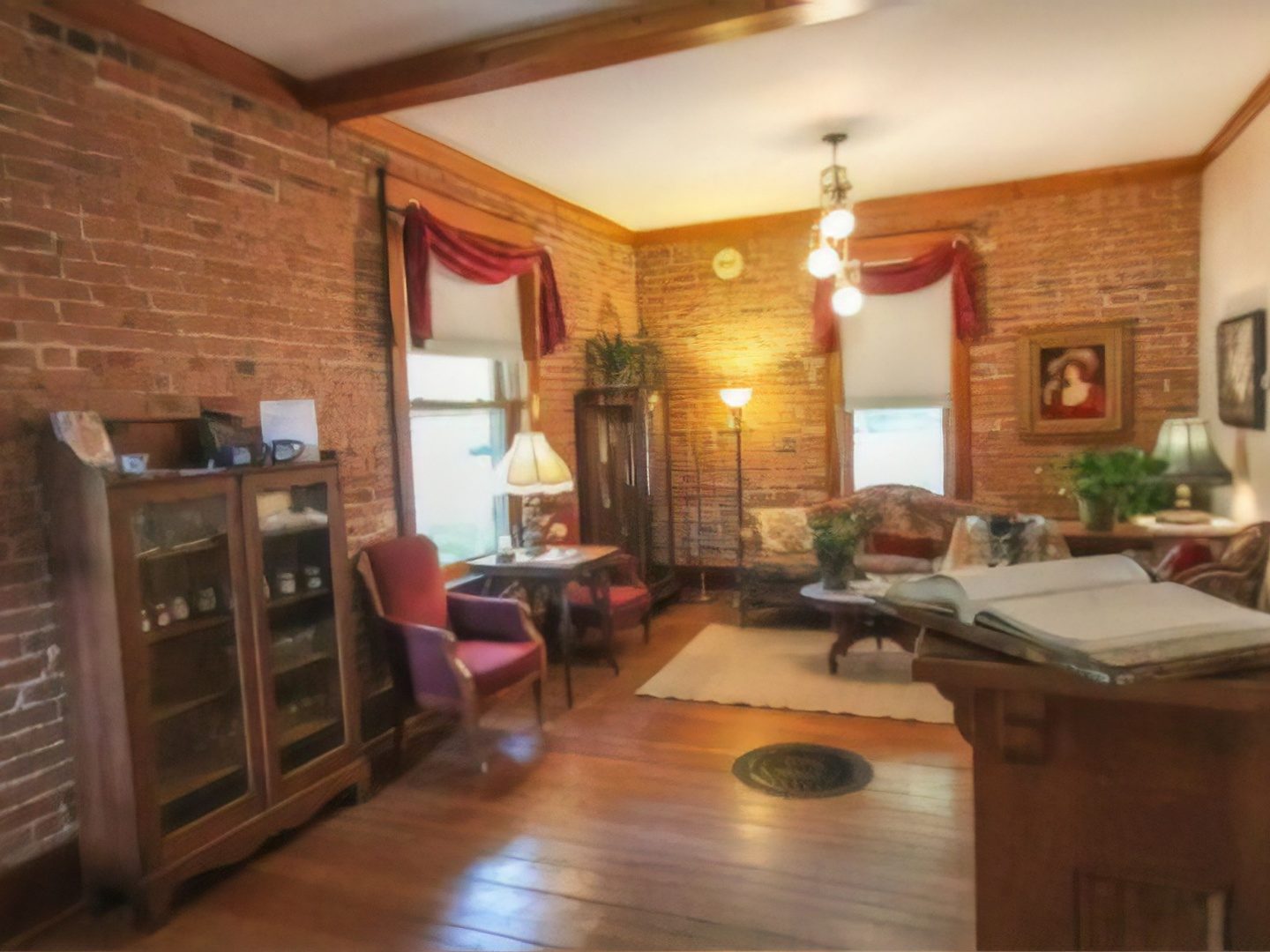 A living room filled with furniture and a fire place at Bross Hotel Bed & Breakfast.