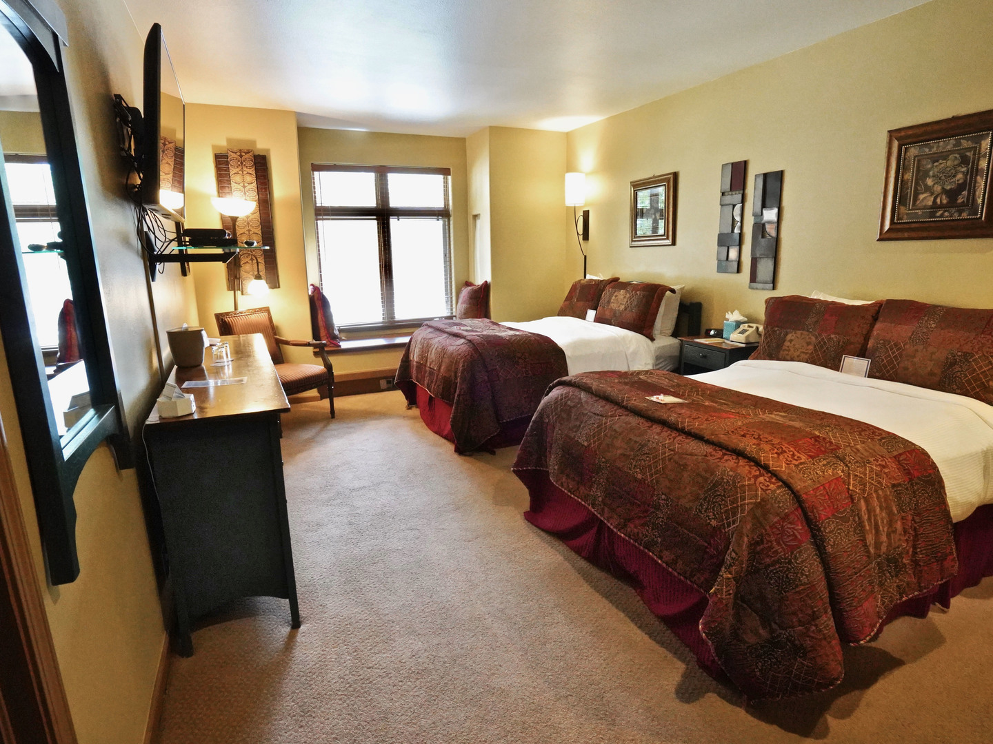 A bedroom with a large bed in a hotel room at Frisco Inn on Galena.