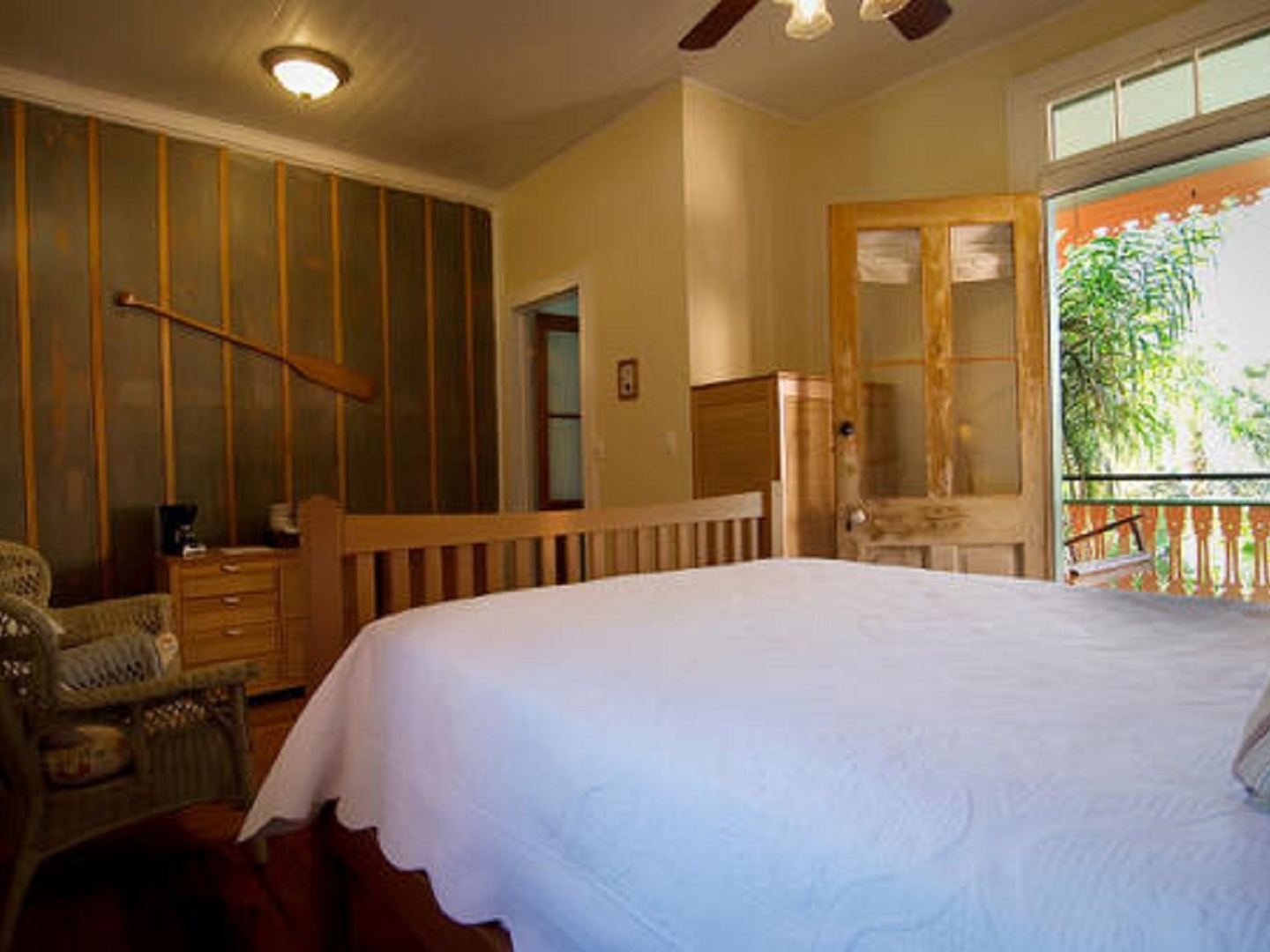 A bedroom with a large bed in a room at Marvilla Guest House.