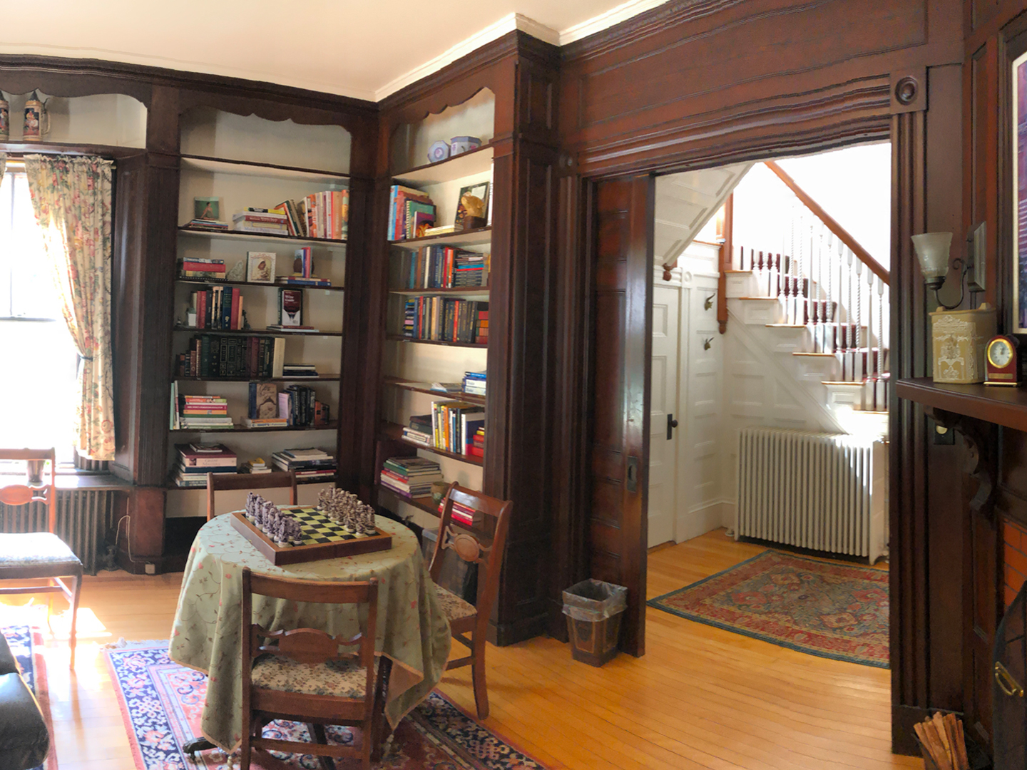 A room filled with furniture and a book shelf at Guilford Bed and Breakfast.