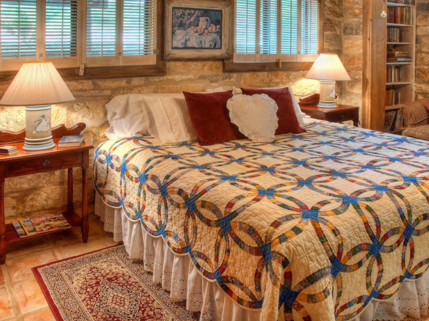 A bedroom with a large bed in a room at Historic Kuebler Waldrip Haus B&B .