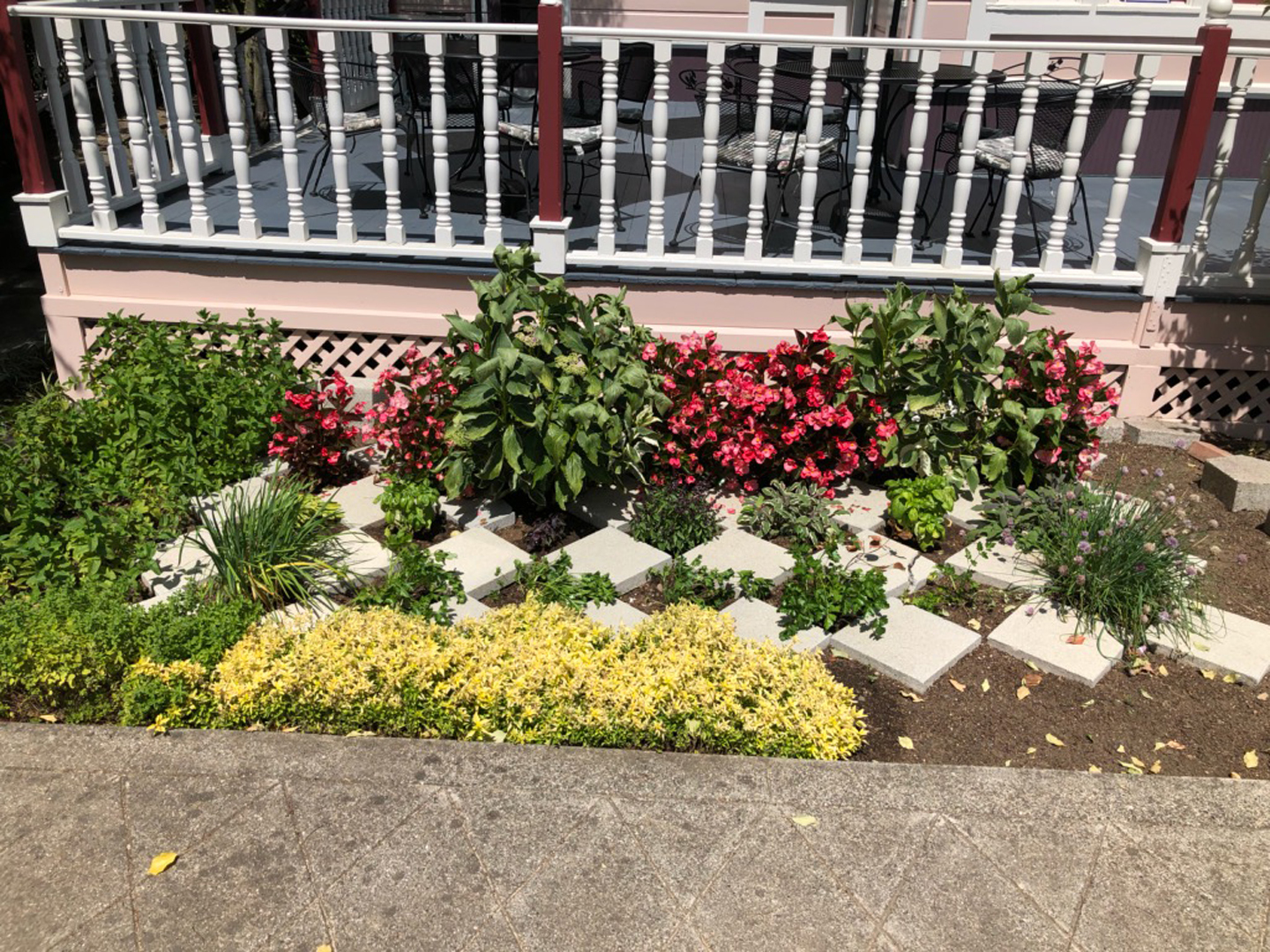A close up of a flower garden in front of a building at Hennessey House.