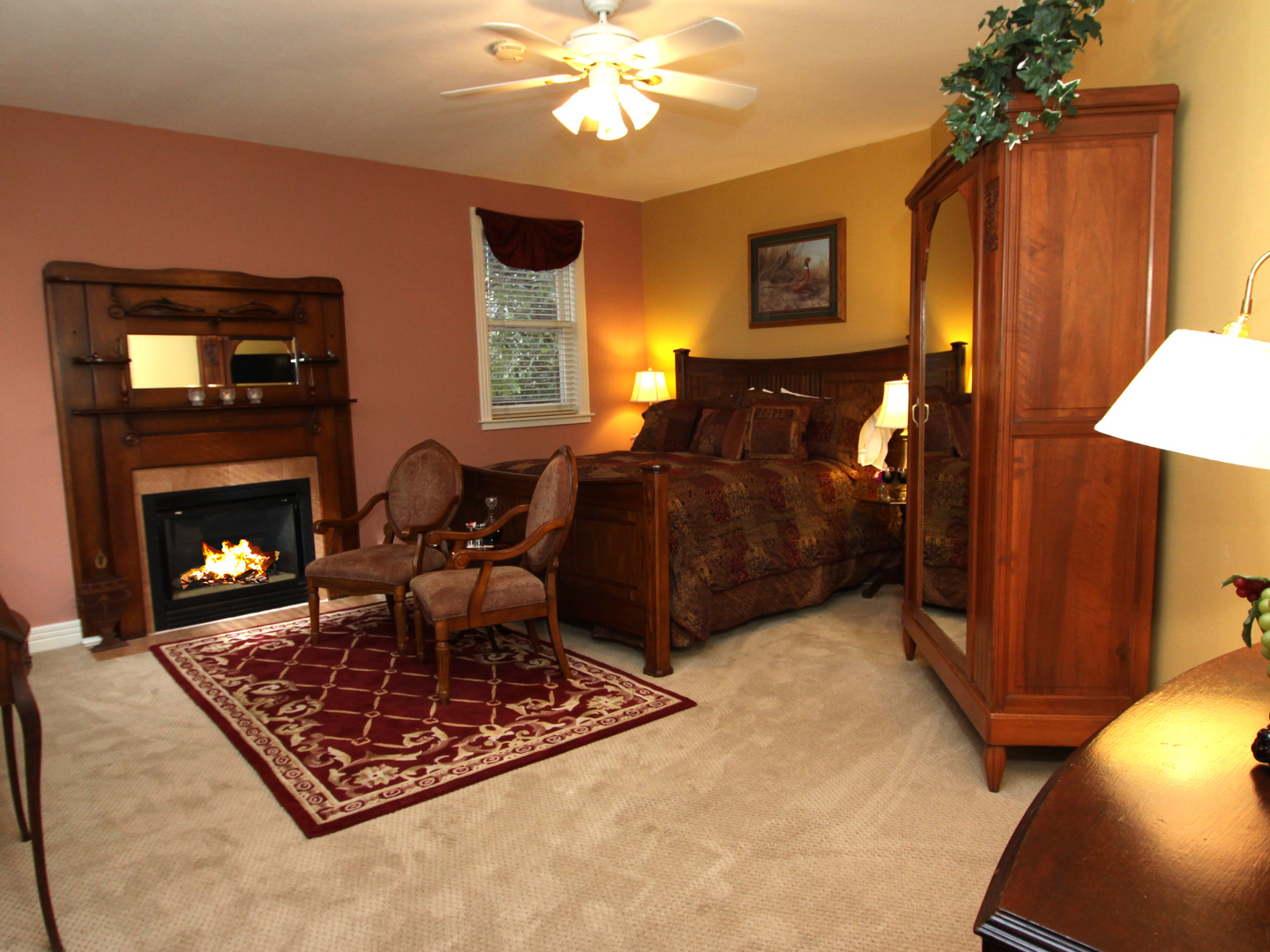 A living room filled with furniture and a fire place at Hennessey House.