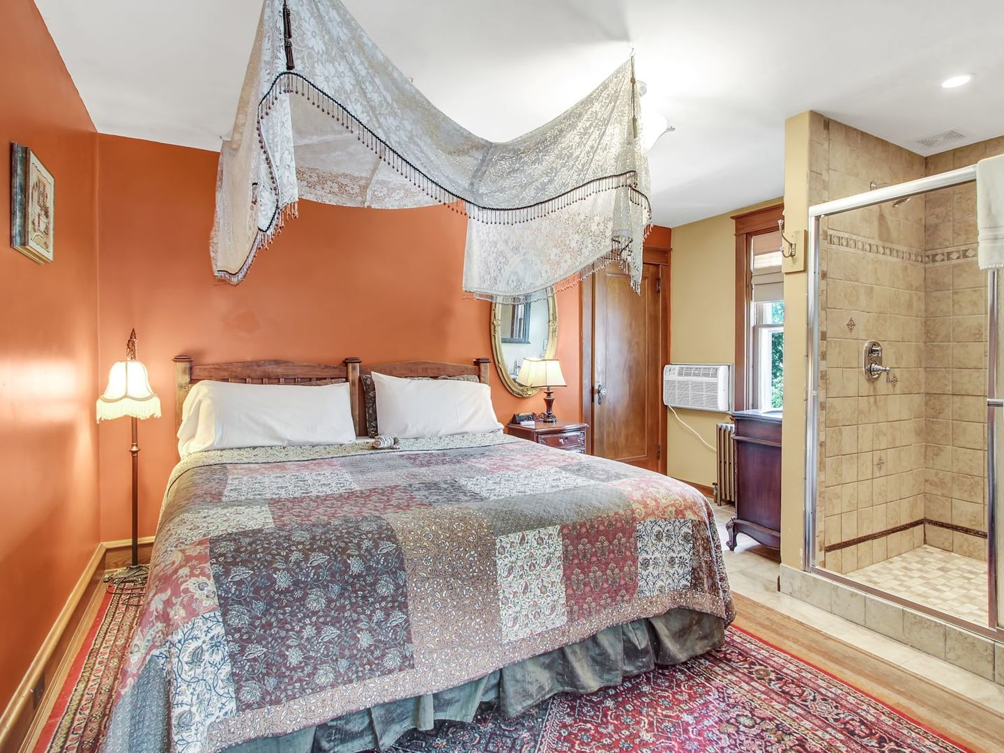A bedroom with a large bed in a room at Australian Walkabout Inn Bed & Breakfast.