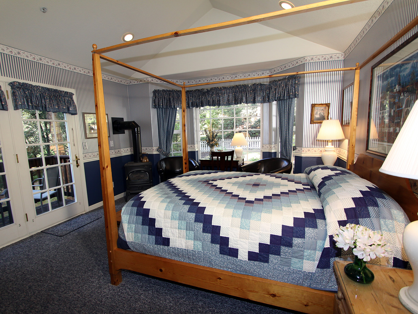 A large bed in a room at McCaffrey House Bed & Breakfast Inn.