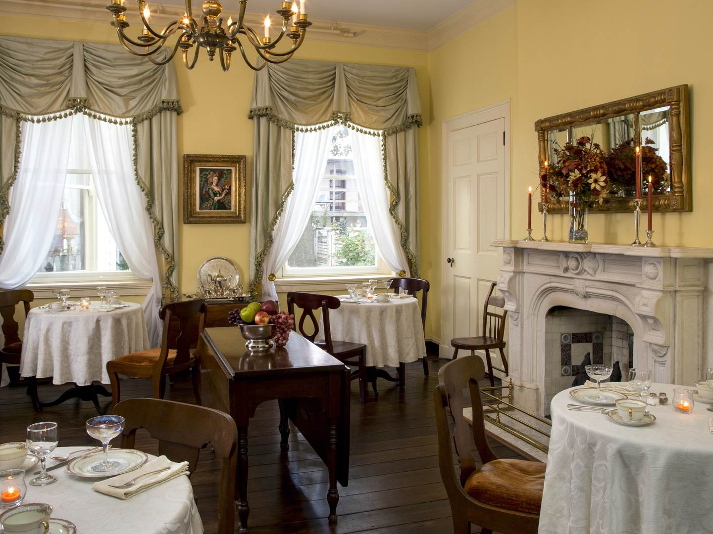 A room filled with furniture and a fireplace at Rachael's Dowry Bed and Breakfast.