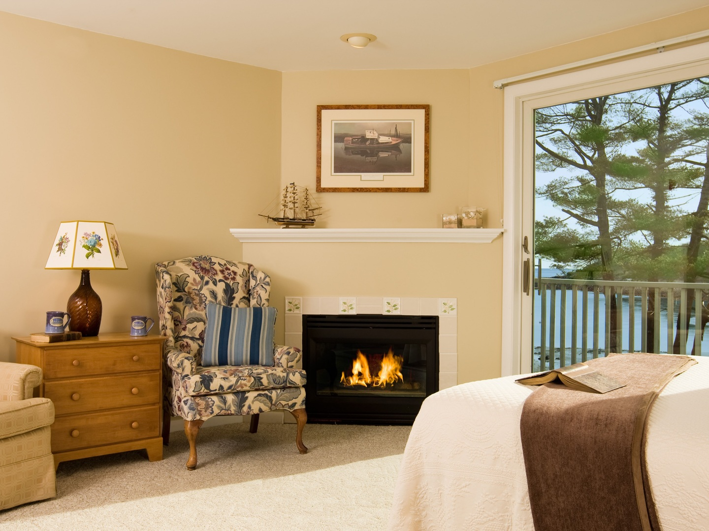 A living room filled with furniture and a fireplace at Dockside Guest Quarters.