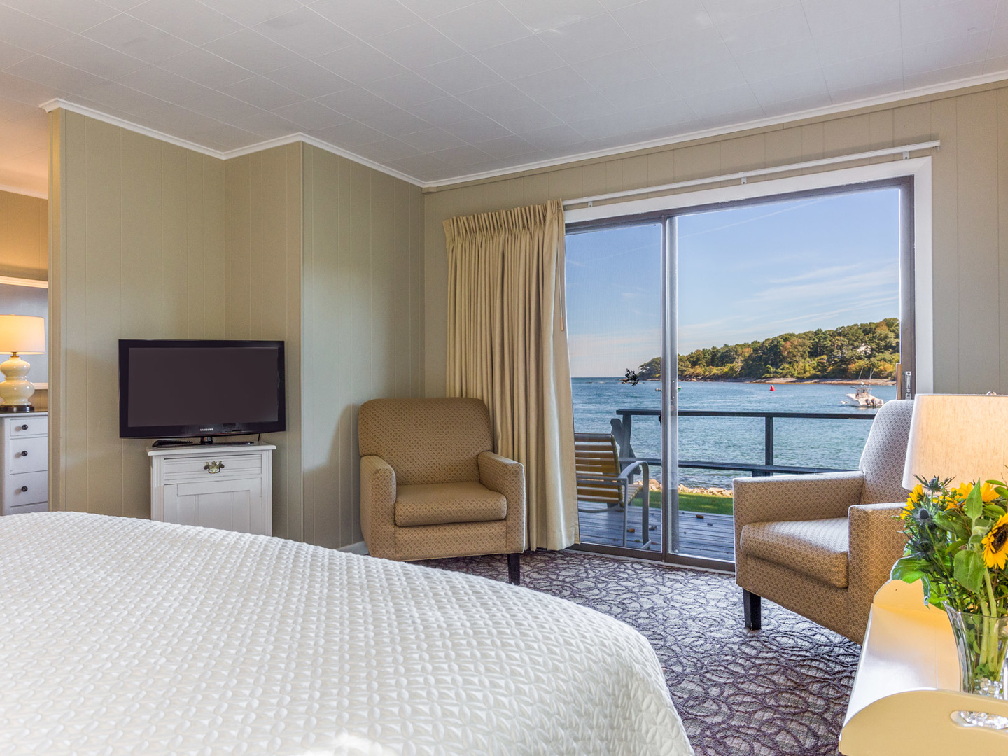 A bedroom with a large bed in a hotel room at Dockside Guest Quarters.