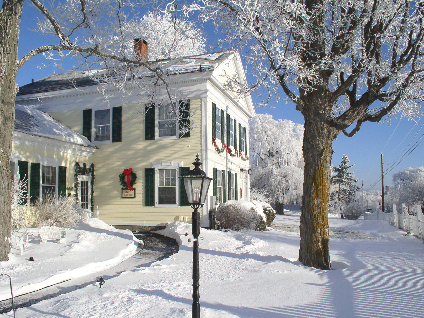A house covered in snow at Strong House Inn.
