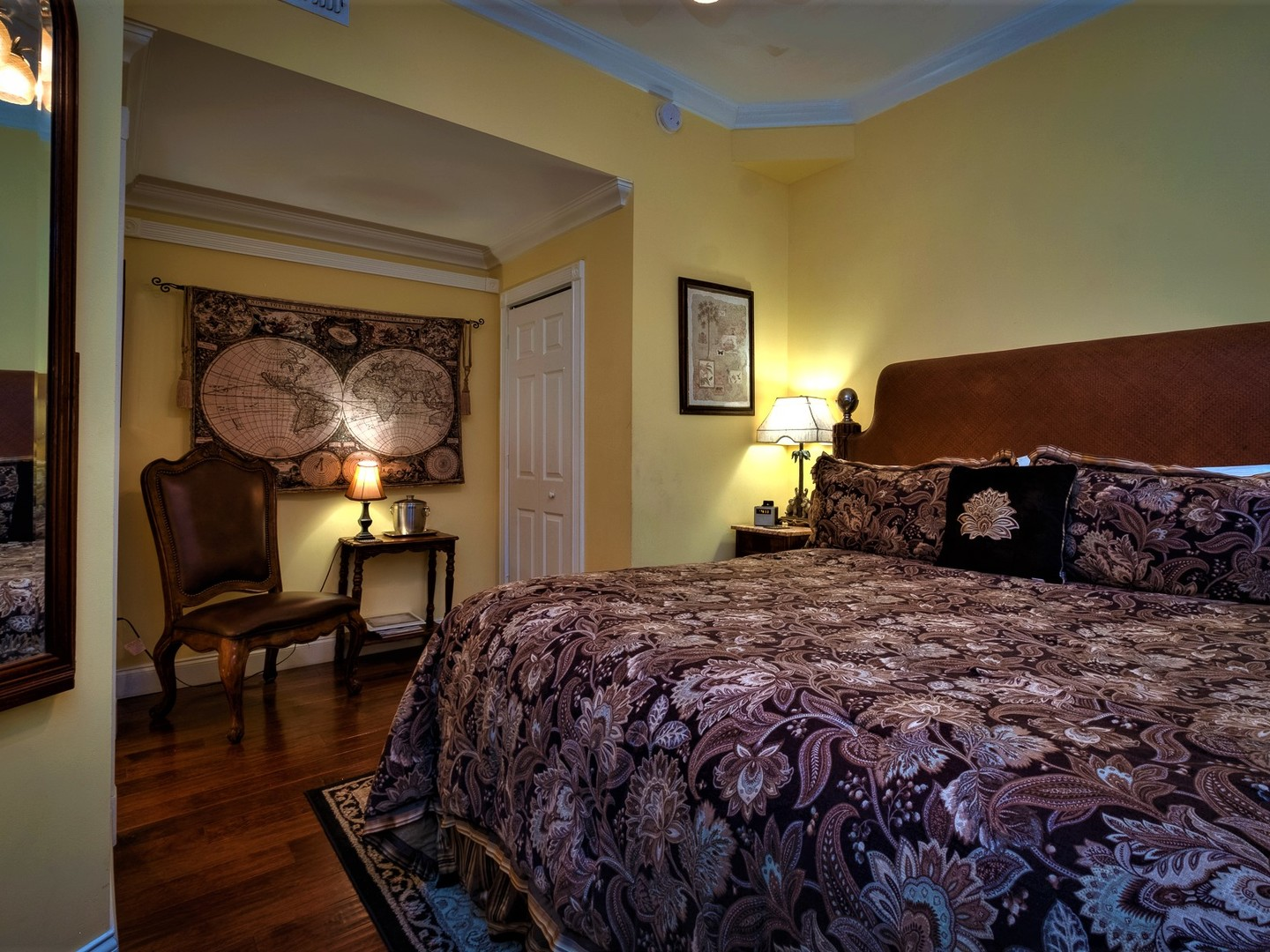 A bedroom with a large bed in a room at Victorian House B&B.