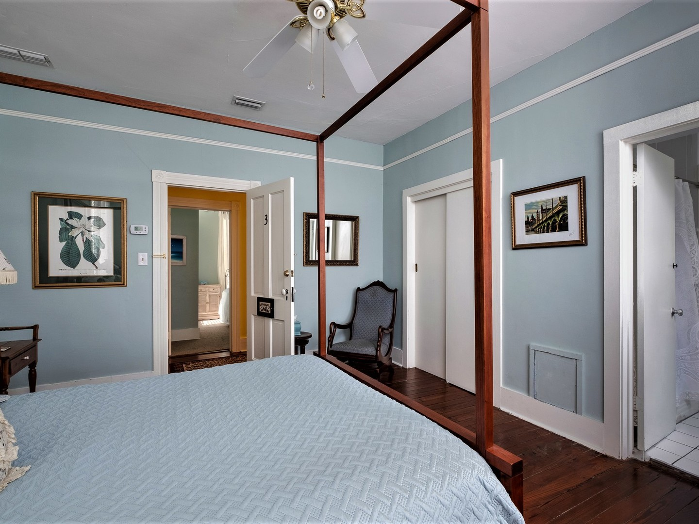 A bedroom with a bed in a room at Victorian House B&B.