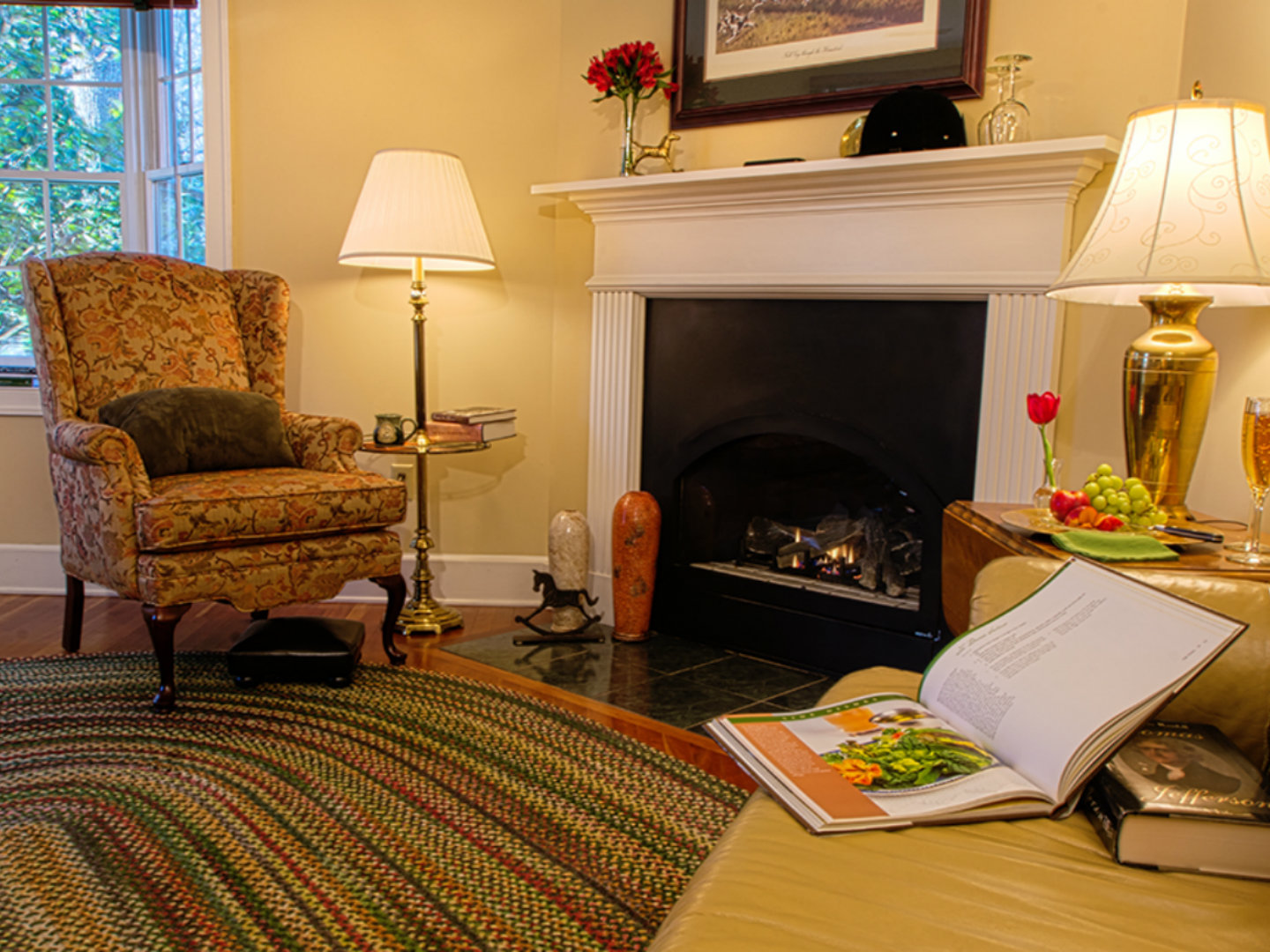 A living room filled with furniture and a fire place at Foxfield Inn.
