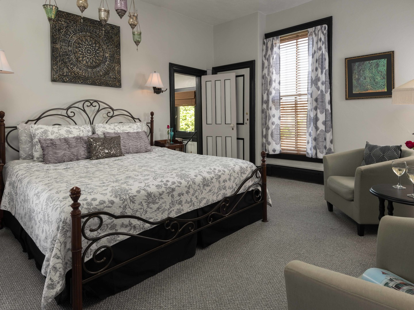 A bedroom with a bed and desk in a hotel room at Mooring Bed & Breakfast.
