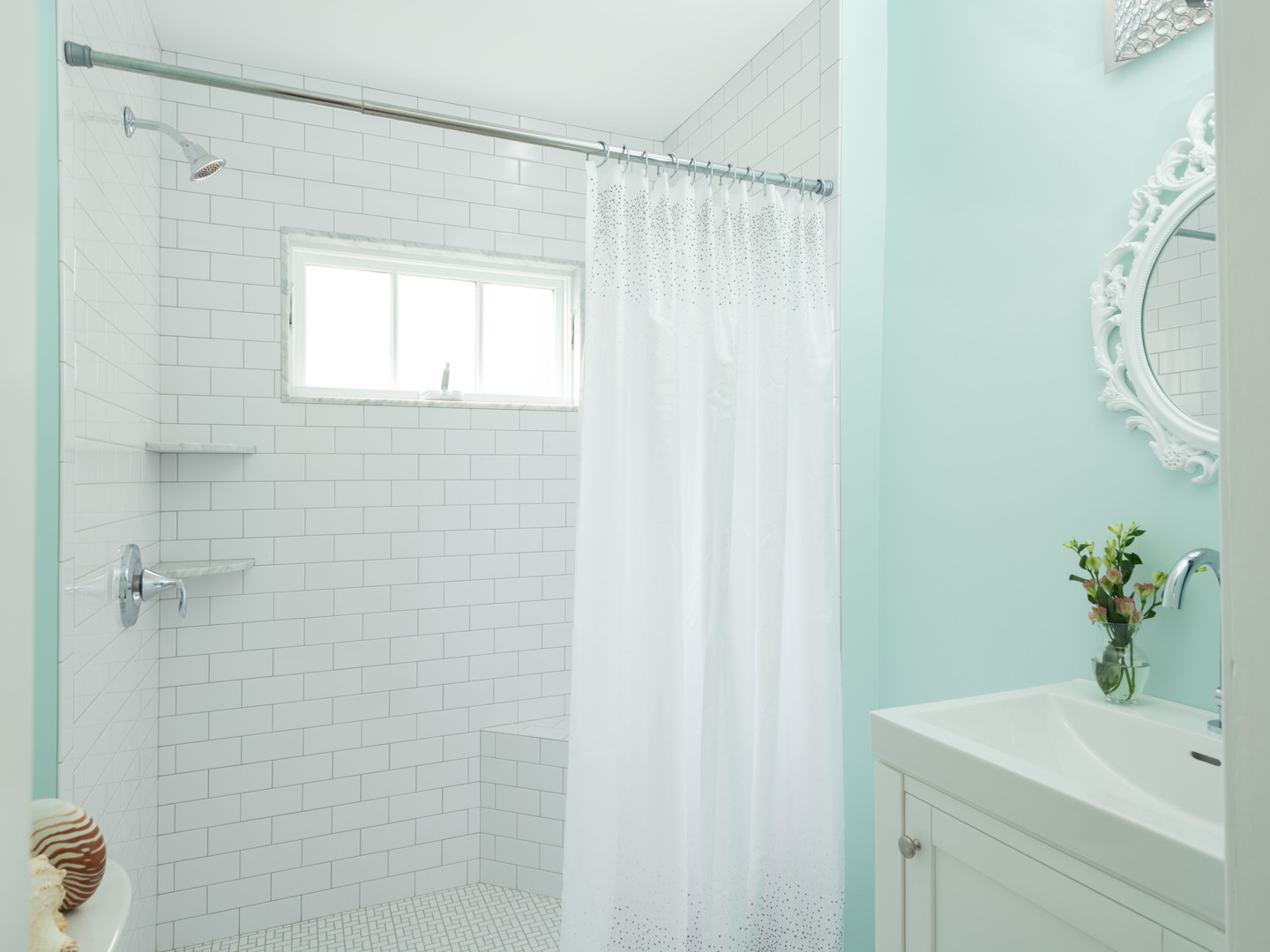A blue and white shower curtain at Mooring Bed & Breakfast.