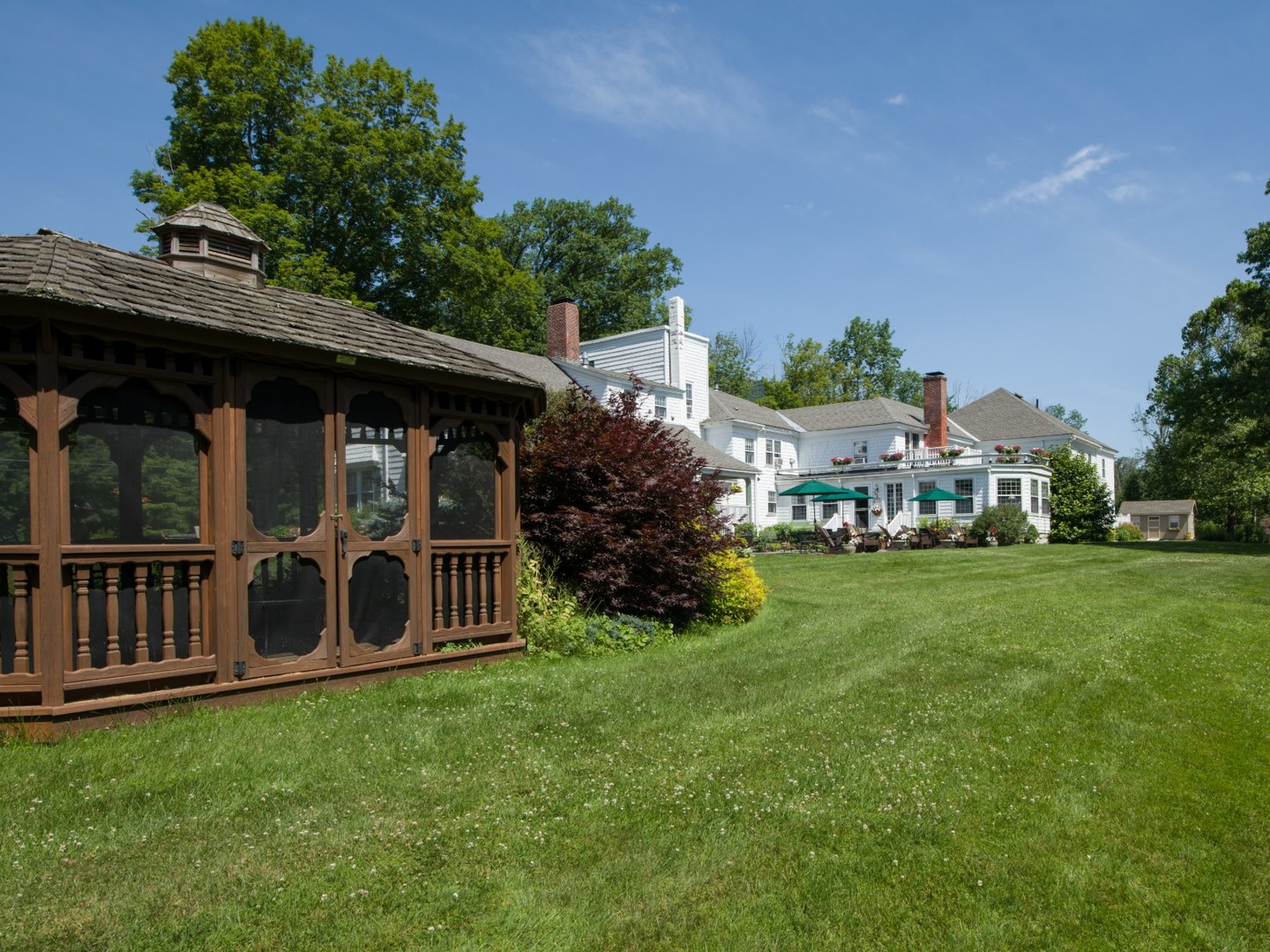 A large lawn in front of a house at The Inn at Ormsby Hill.