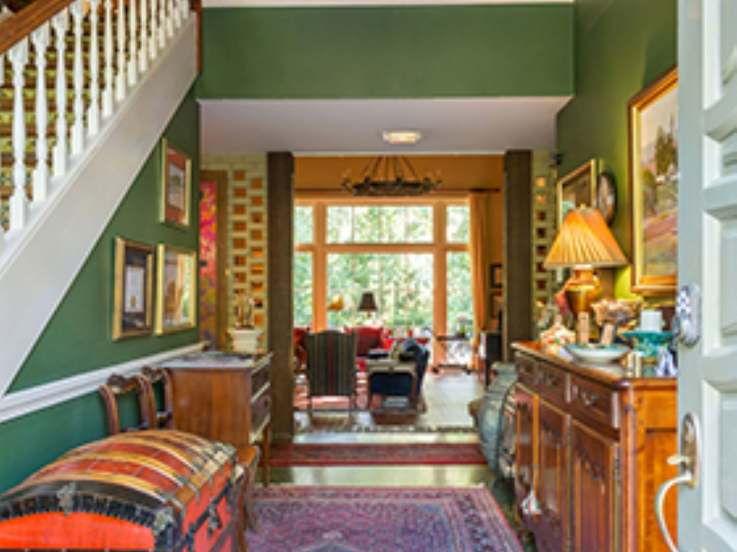 A room filled with furniture and a large window at The Stockade Bed & Breakfast.