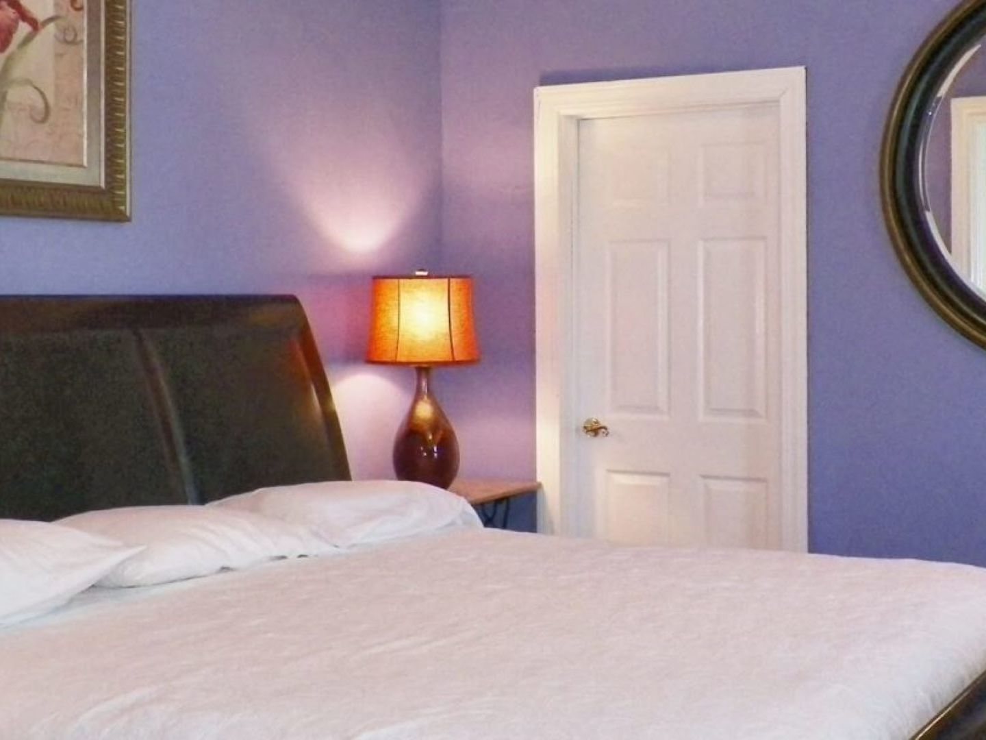 A bedroom with a large bed in a room at Blueberry Cove Inn.