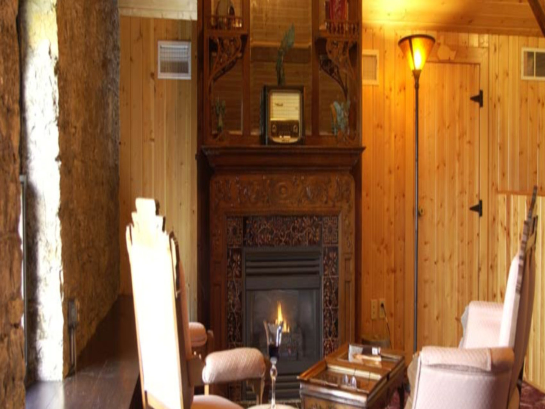A wooden chair in a room at Moondance Inn.