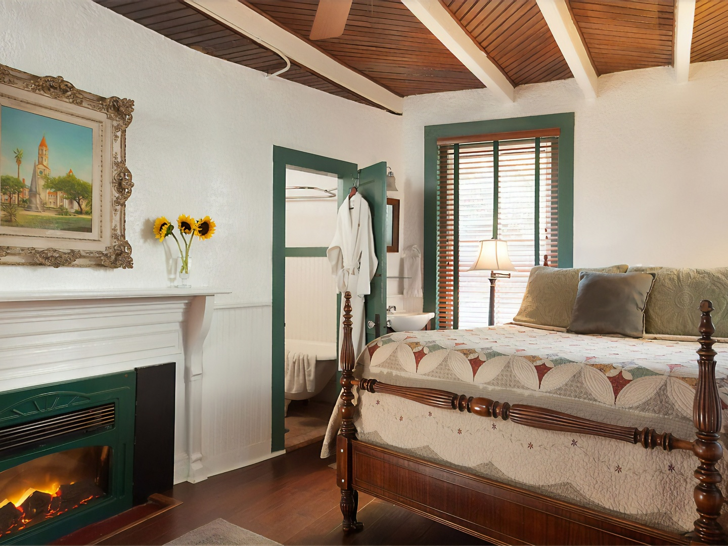A bedroom with a bed and a fireplace at St. Francis Inn.
