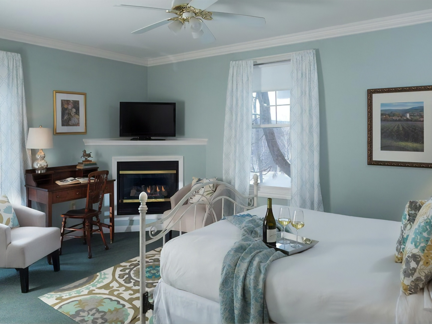 A bedroom with a bed and a chair in a room at Hampton Terrace Inn.