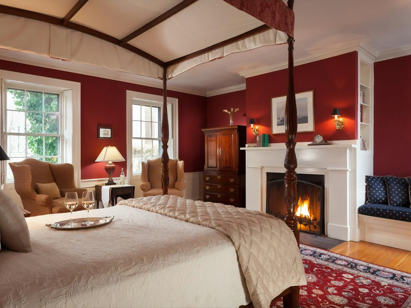 A living room with a bed and a fireplace at Harbor Light Inn.