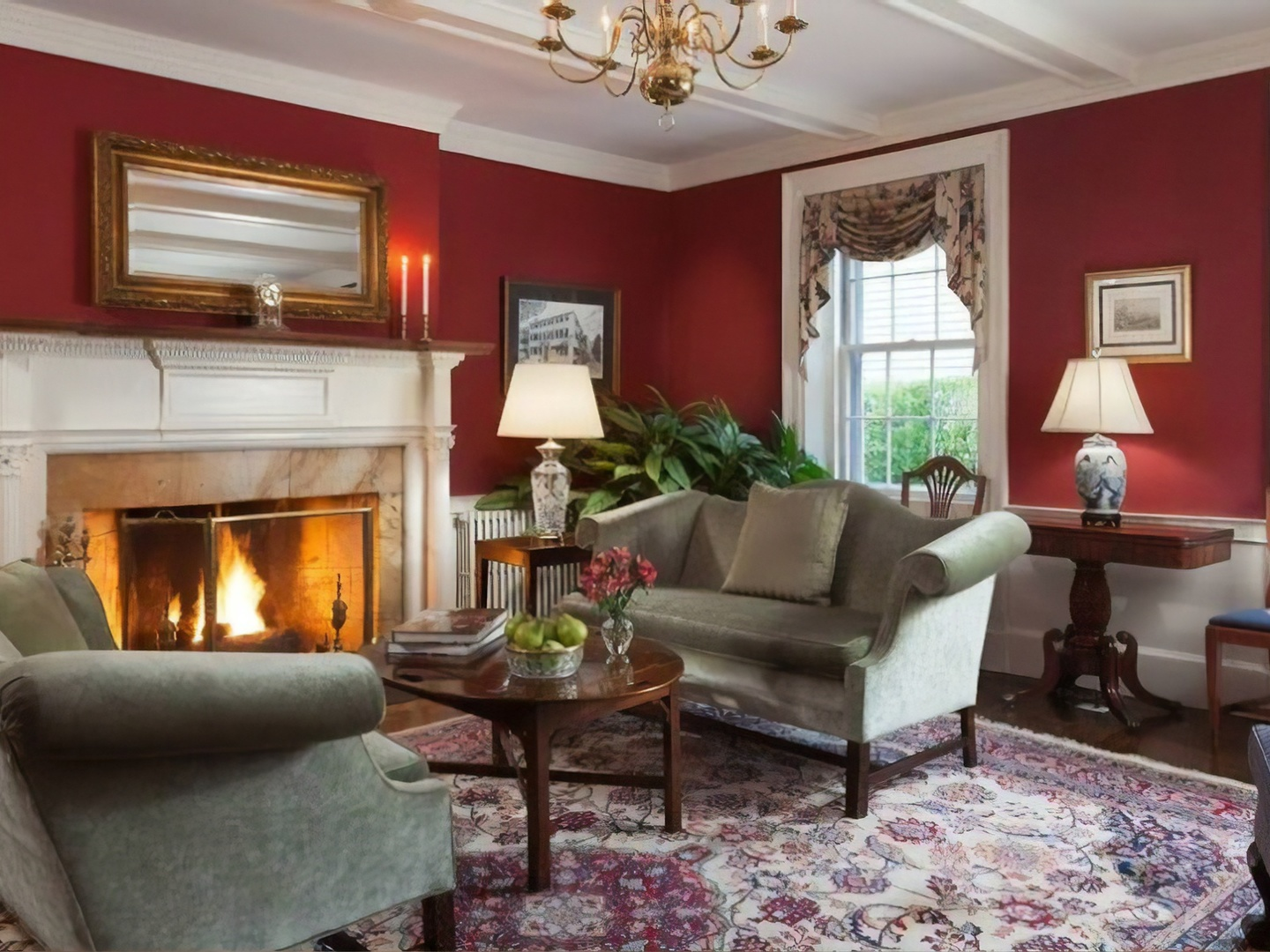 A living room filled with furniture and a fire place at Harbor Light Inn.